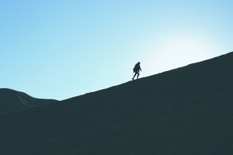 silhouette of a mountain climber