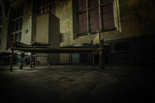 bed in an abandoned asylum