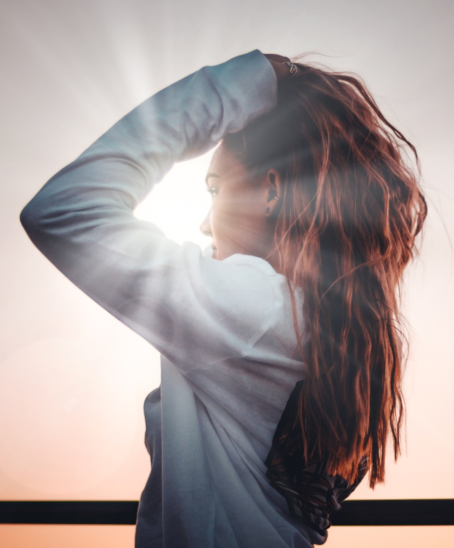 girl standing in front of sunrise