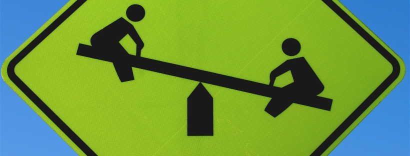 seesaw shown on a road sign