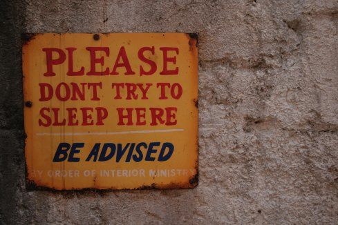 """Please don't try to sleep here"" sign"