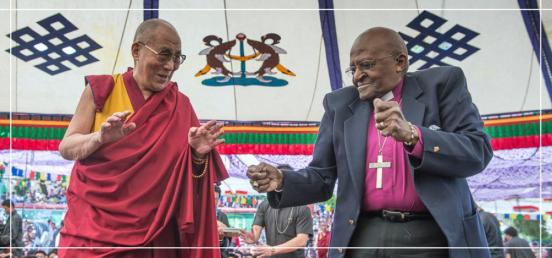 The Dalai Lama and Archbishop Tutu dancing