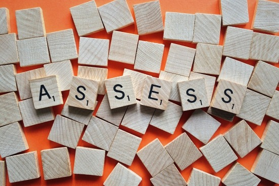 assess written in Scrabble tiles