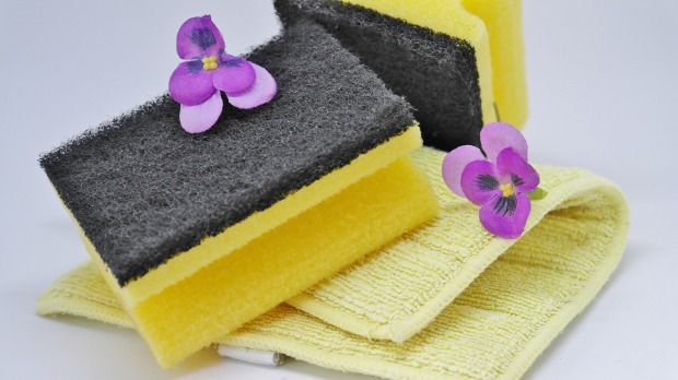 yellow cleaning supplies and flowers