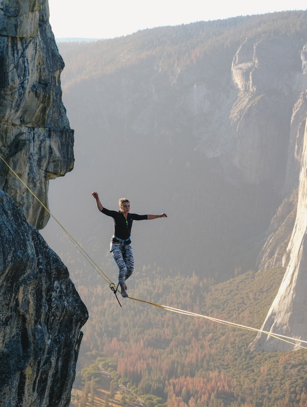 person walking on a tightrope