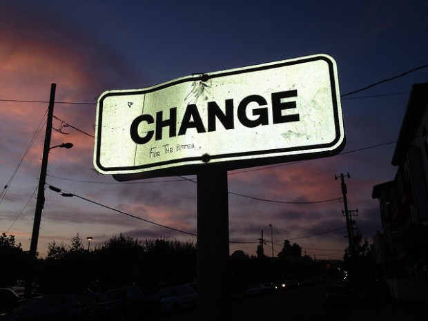 "lit up sign with the word ""change"""