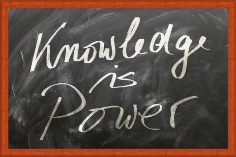 """""""knowledge is power"""" written on a chalkboard"""