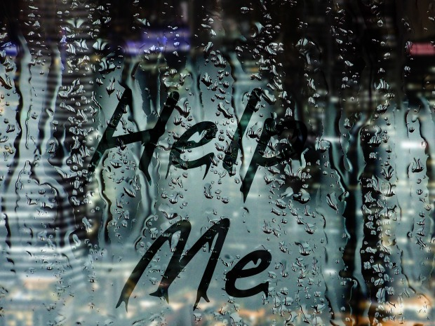 """help me"" marked on a foggy window"