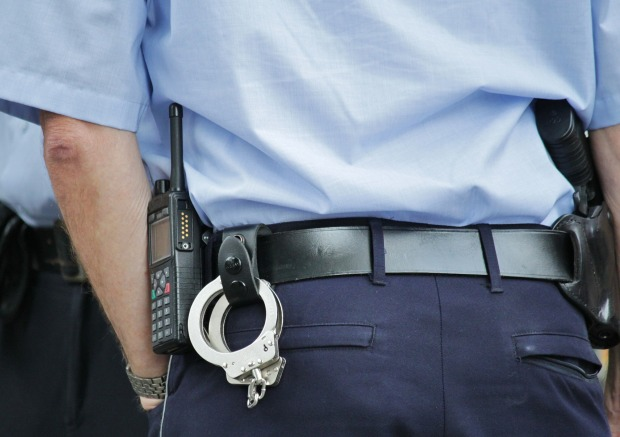 police officer with handcuffs and gun on waistbelt