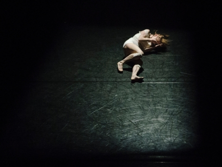 person lying on the floor in a dark room