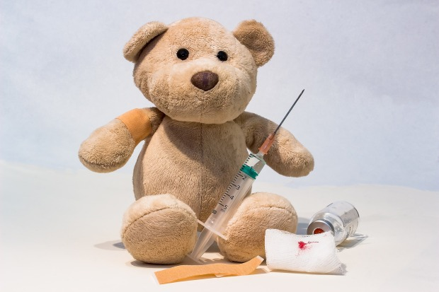 teddy bear with a syringe and vial