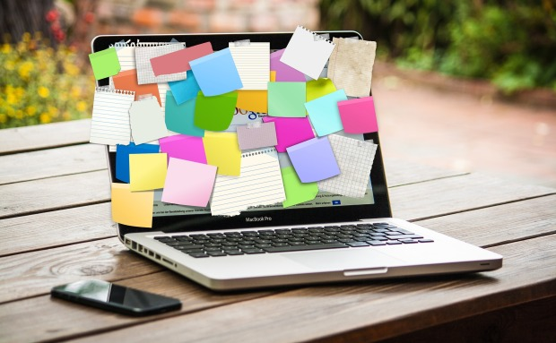 sticky notes covering laptop screen