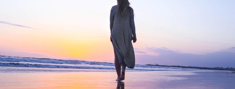 woman walking along the beach alone