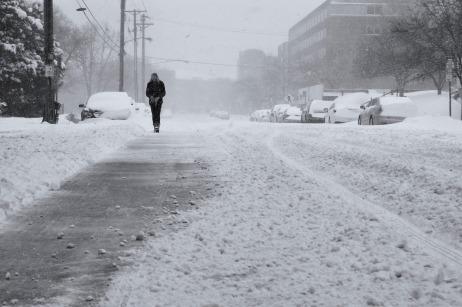person walking on snowy street