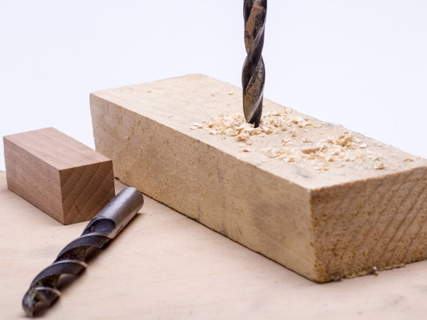 drilling into block of wood