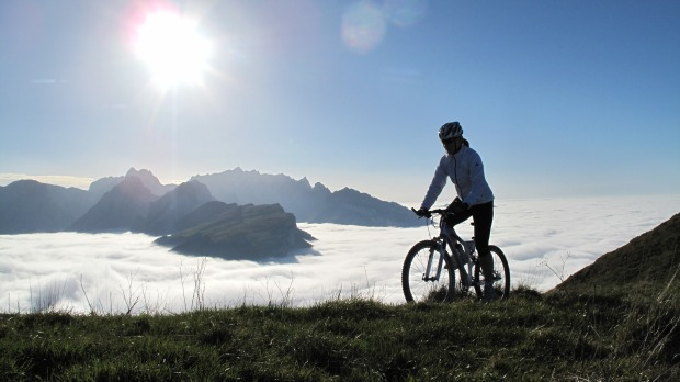 mountain biker at elevation above clouds