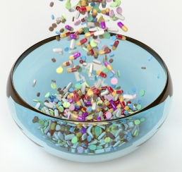 pills being poured into a glass bowl